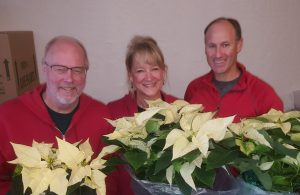 Normal Rotarians prepare poinsettias for pick-up.